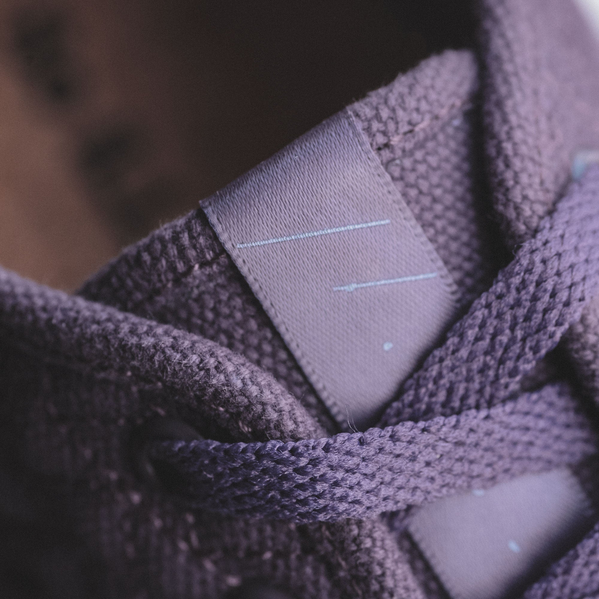 unity purple roamer showing the tongue tab of the shoe