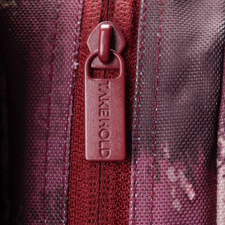 Close up of So iLL x On The Roam crash pad zipper