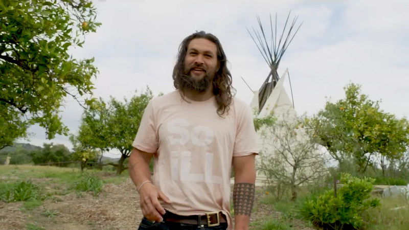 Jason Momoa wearing Dirty Pink So iLL Stacked Logo Tee