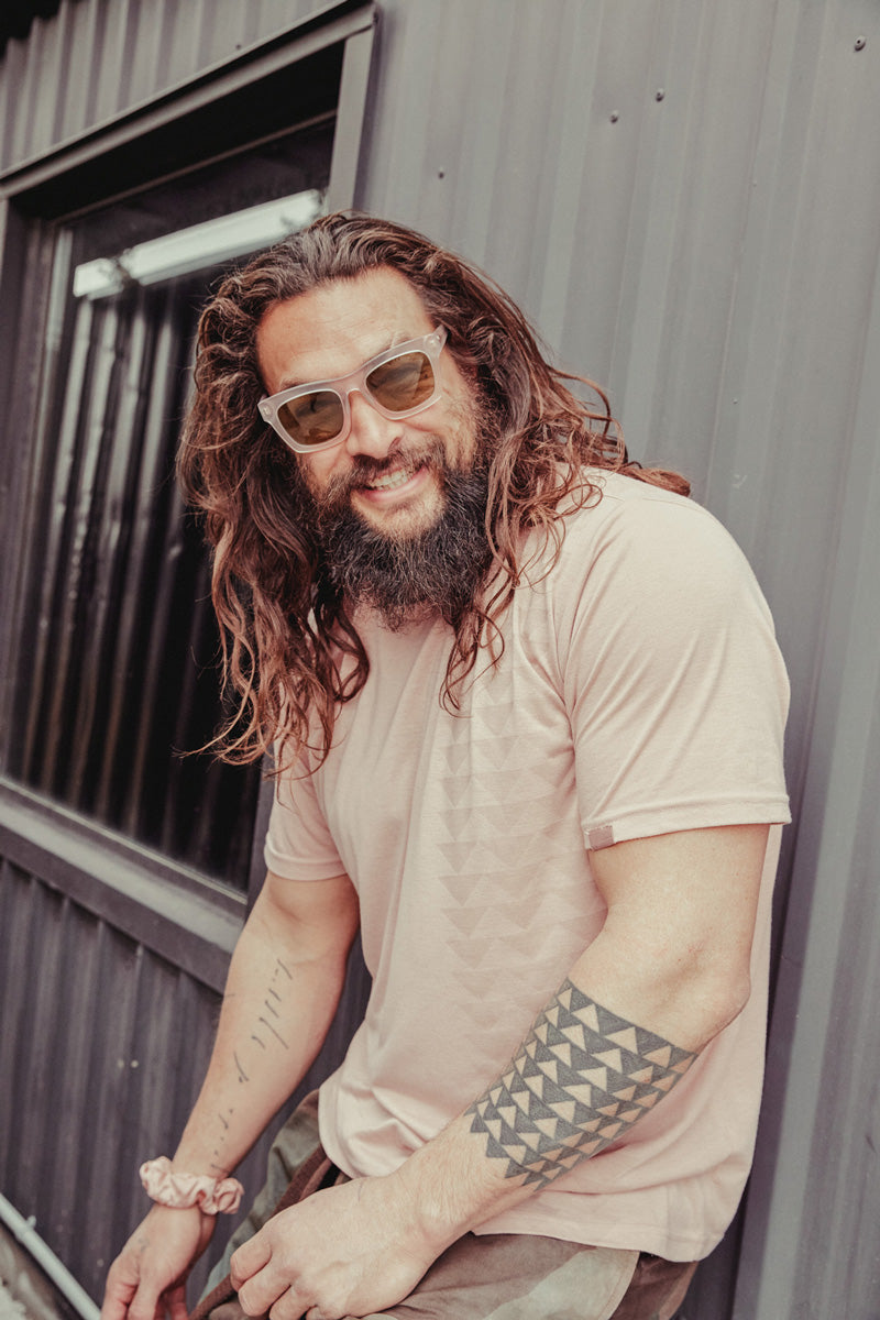 Jason Momoa hanging out in the so ill x on the roam nakoa dirty pink tee shirt