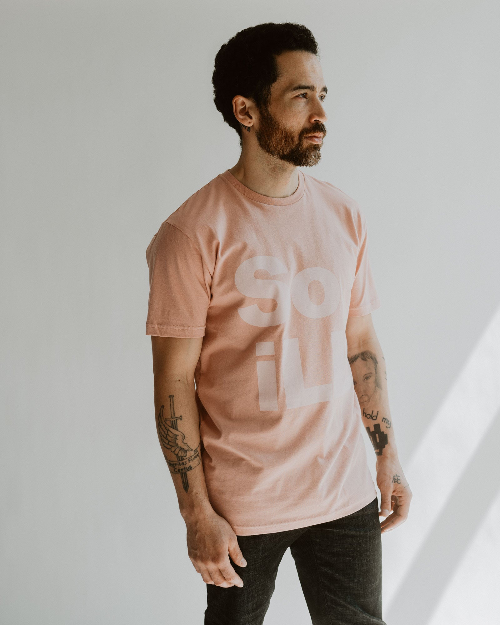 Dirty Pink so ill stacked logo tee is shown on a man