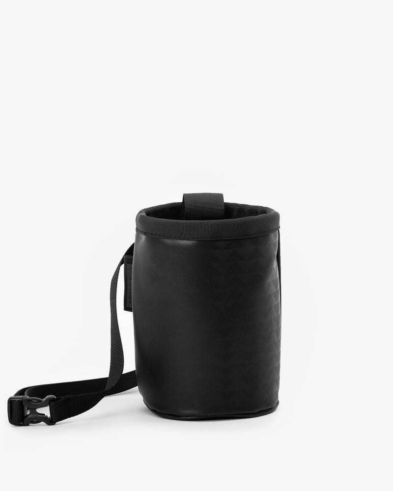 So iLL and On The Roam collaboration black wolf chalk bag with waist belt and cinch closure, designed by Jason Momoa. Front view on grey background.