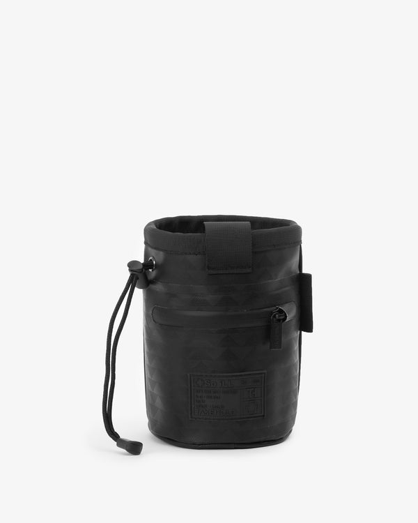 So iLL and On The Roam collaboration black wolf chalk bag with waist belt and cinch closure, designed by Jason Momoa. Back view on grey background.