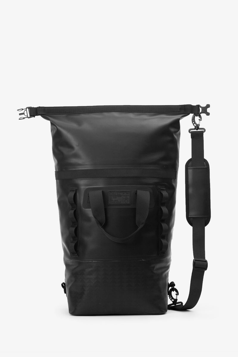 on the roam and so ill collaboration by jason momoa 25L medium black bag on grey background