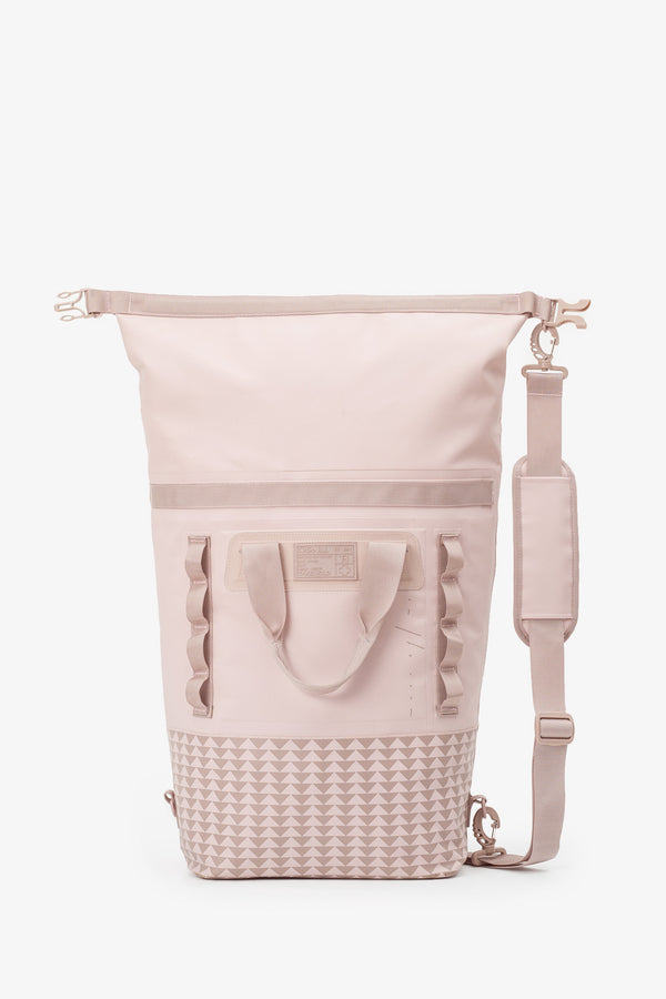 on the roam and so ill collaboration by jason momoa 25L medium pink bag on grey background