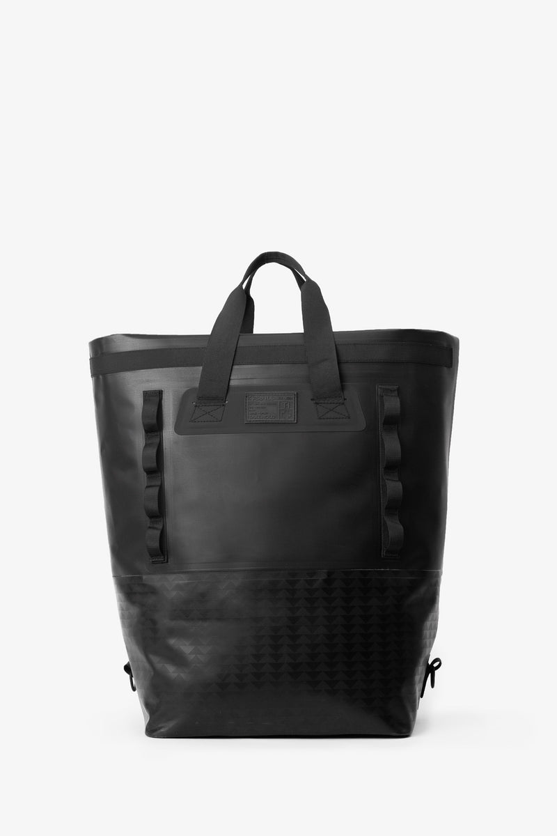 on the roam and so ill collaboration by jason momoa 45L medium black bag on grey background