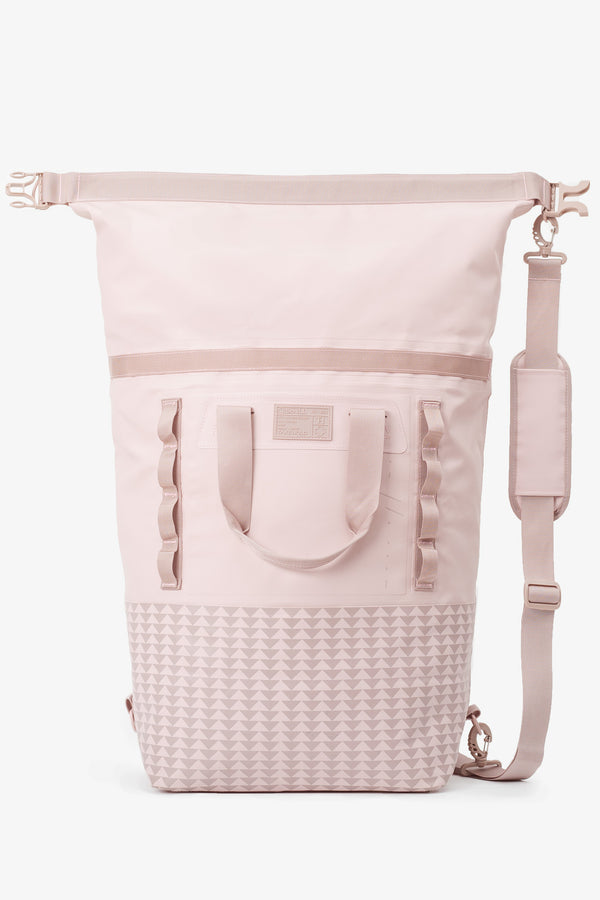 on the roam and so ill collaboration by jason momoa 45L medium pink bag on grey background