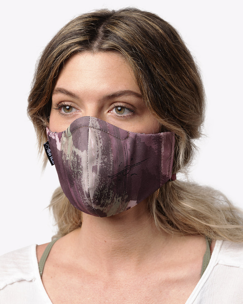 jason momoa collaboration on the roam x so ill face mask in camo color on a female mode