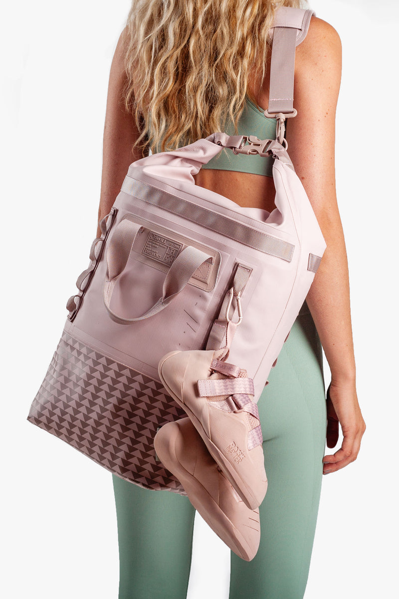 on the roam and so ill collaboration by jason momoa 25L medium pink bag on female model with climbing shoes