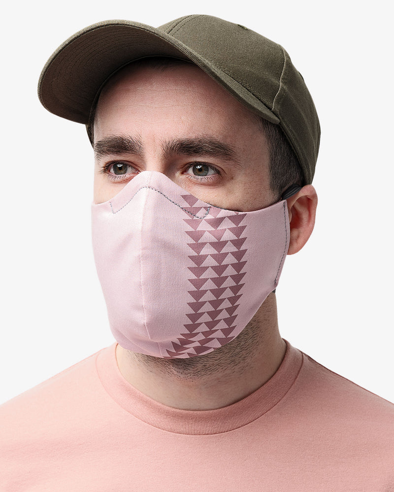 Front view of male wearing So iLL x On The Roam Dirty Pink face mask