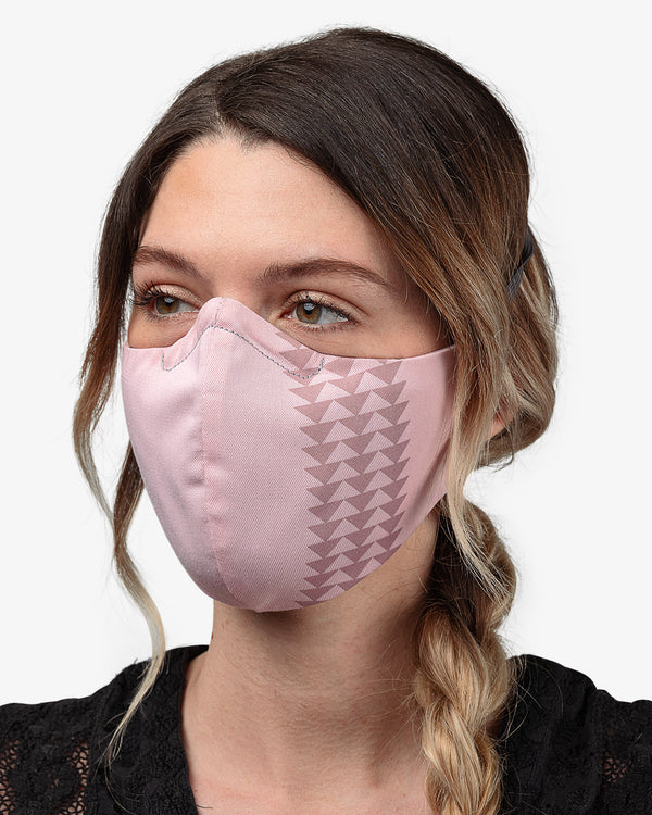 Female wearing Dirty Pink So iLL x On The Roam face mask  Edit alt text