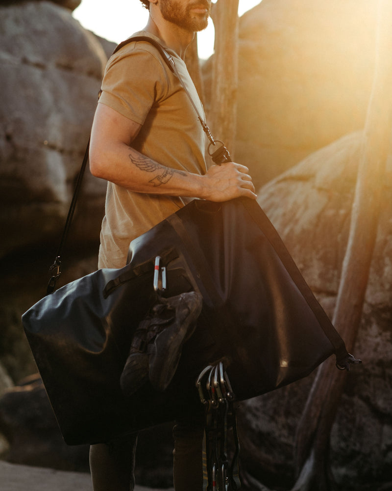 on the roam and so ill collaboration by jason momoa 45L medium black bag on male model