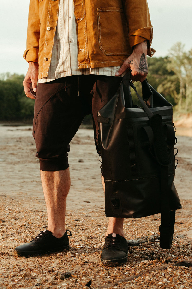 on the roam and so ill collaboration by jason momoa 25L medium black bag with male model