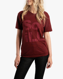 Female wearing Maroon Heather Stacked Logo tee