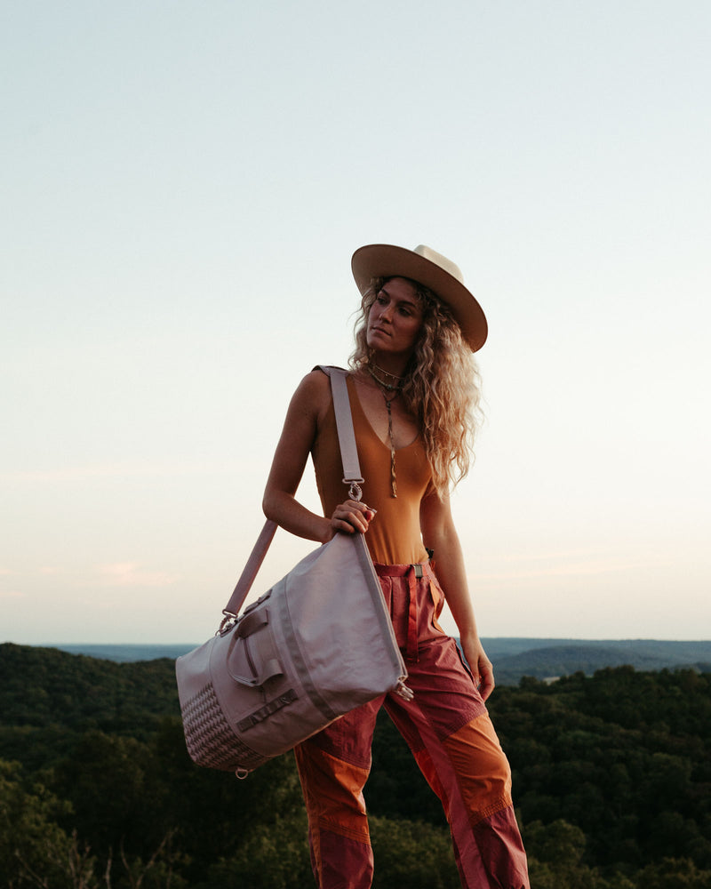 on the roam and so ill collaboration by jason momoa 25L medium pink bag on female model