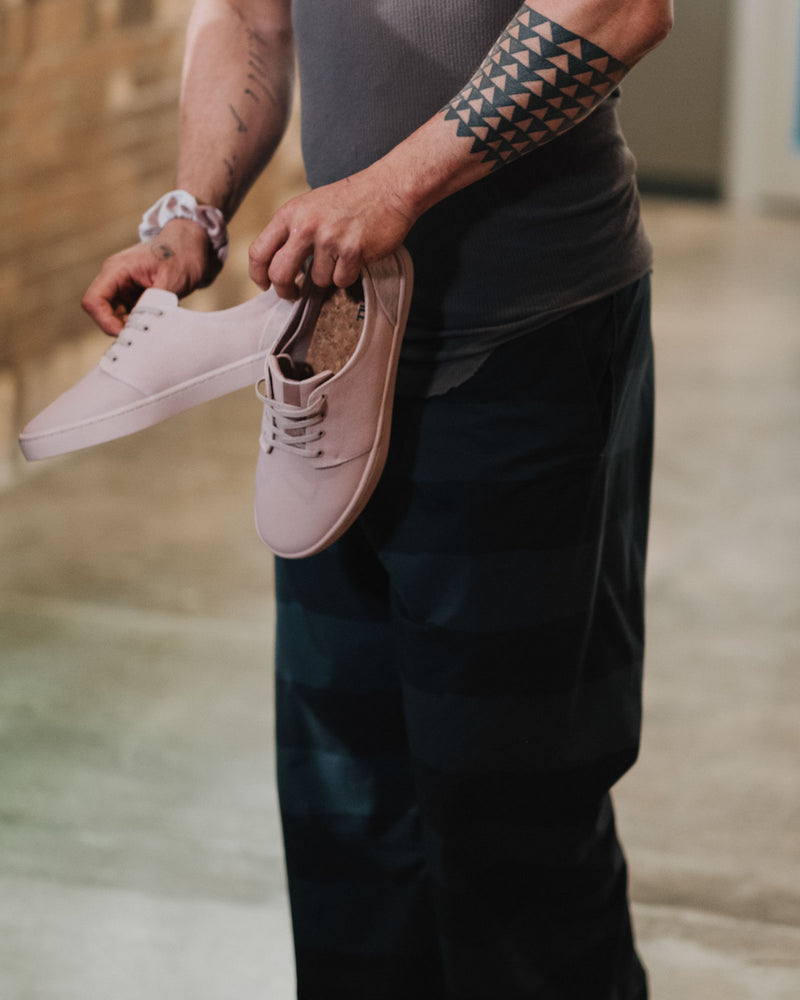 on the roam and so ill collaboration by jason momoa holding pink wolf wino shoes