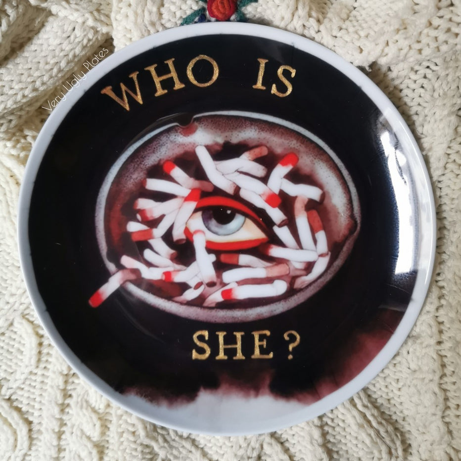 who is she wall plate