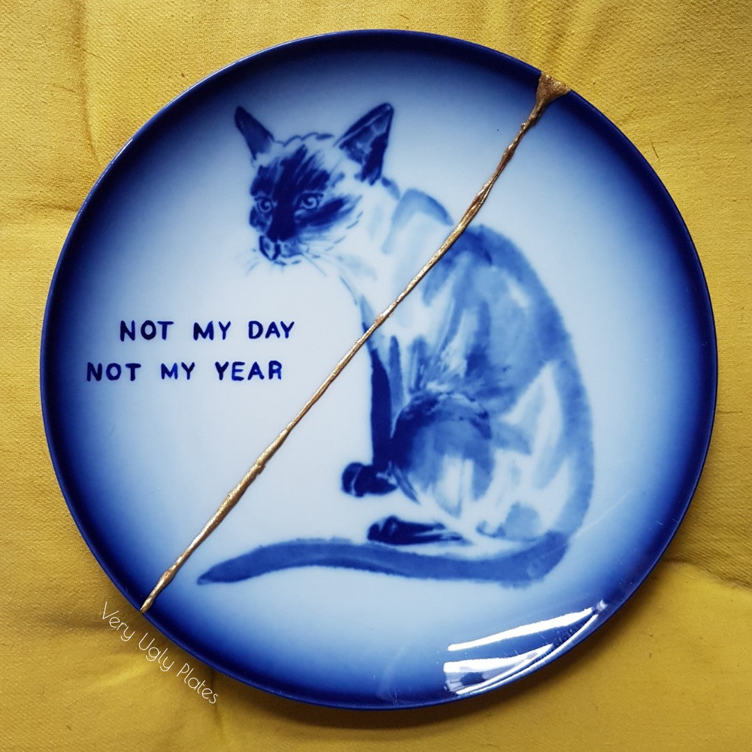 not my day not my year wall plate
