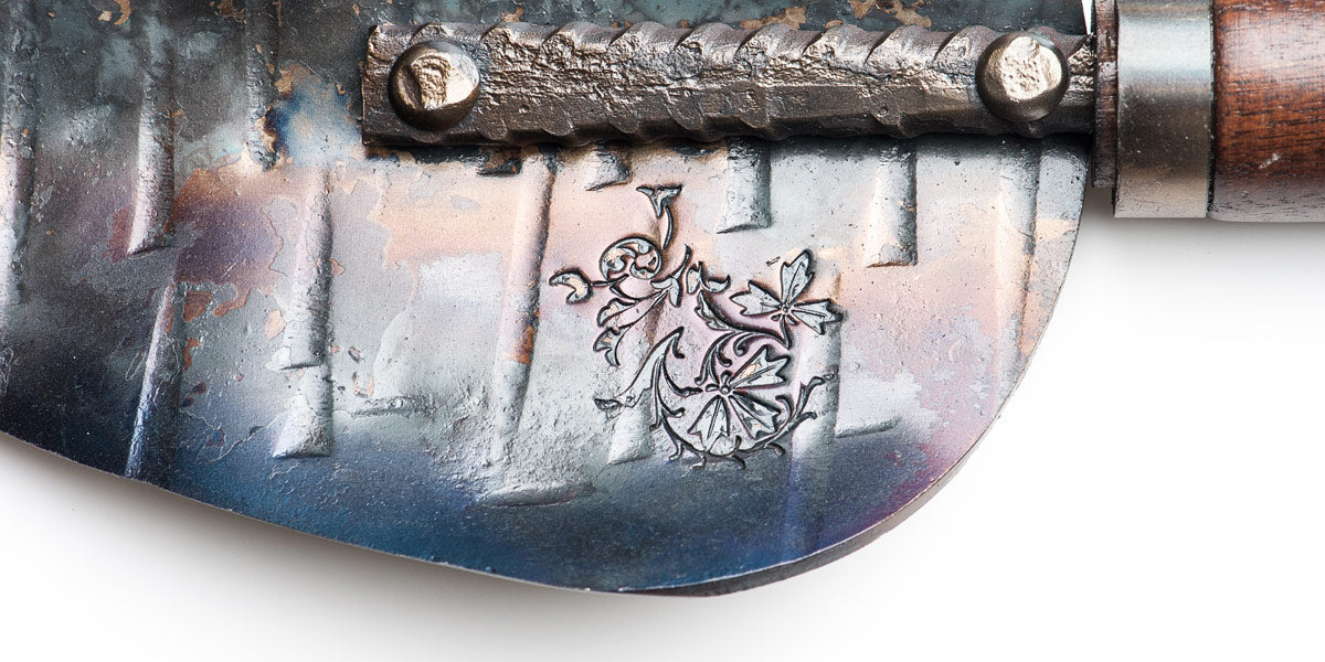close up of floral detail that Tuli Fisher hammers into the metal of his hand crafted garden tools
