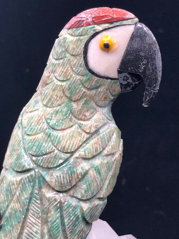 Hand carved parrot (Green Jasper) on a huge quartz crystal.