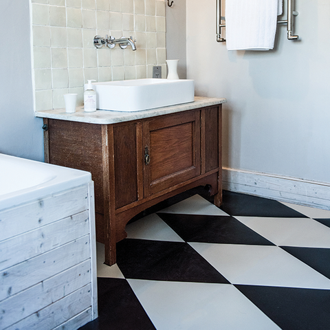 Rubber bathroom flooring in triangle tiles