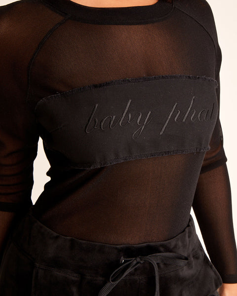 Black stretch mesh bodysuit with Baby Phat embroidered logo on patch at the front. Sheer stretchy fabric and tight fit. Keyhole opening at back.