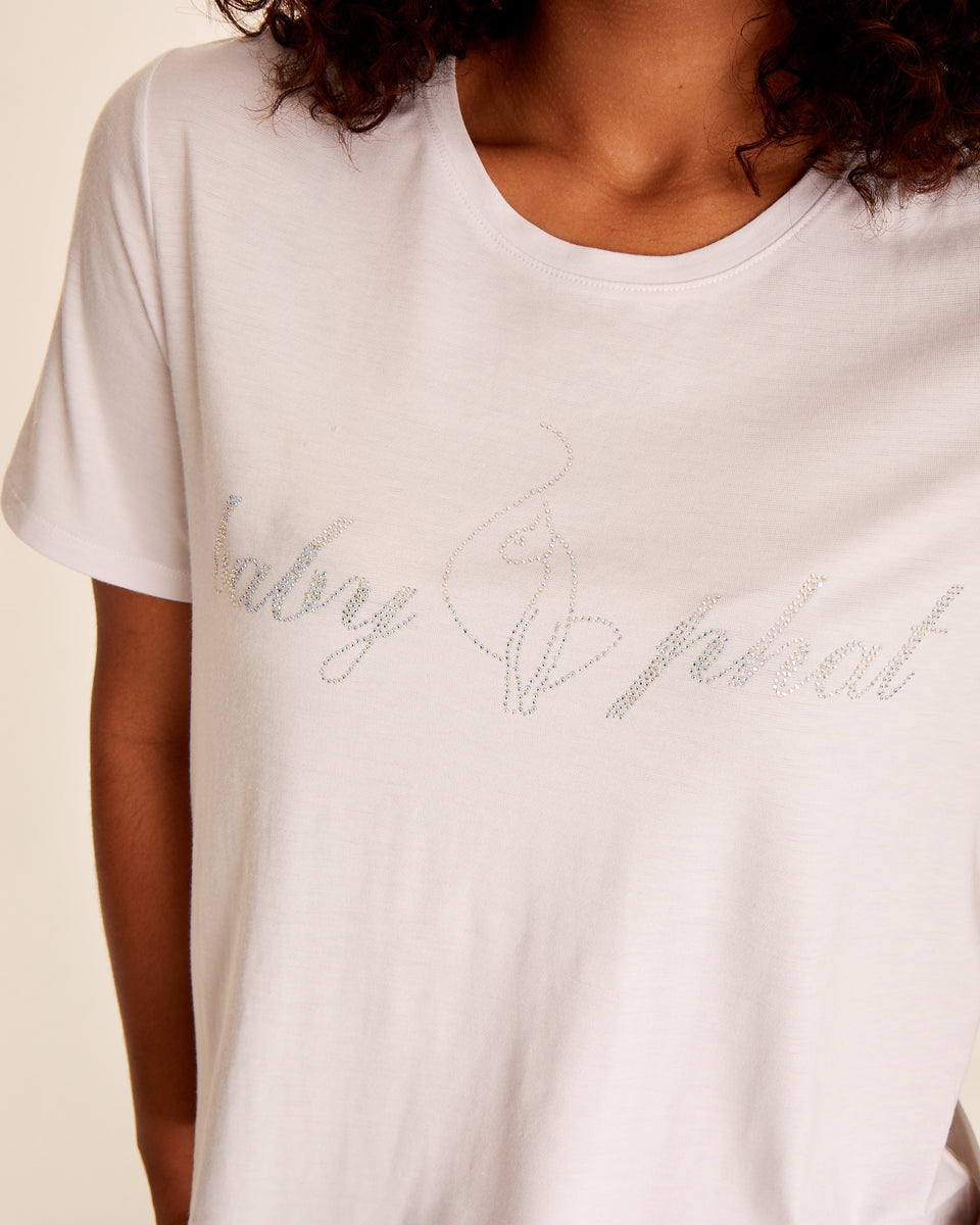 Short sleeved white modal t-shirt with Baby Phat rhinestone logo at the front. Soft, stretchy fabric and boxy fit.