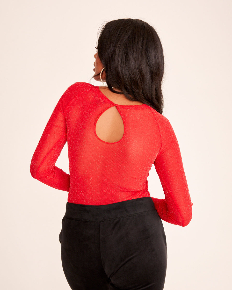 Red stretch mesh bodysuit with Baby Phat embroidered logo on patch at the front. Sheer stretchy fabric and tight fit. Keyhole opening at back.