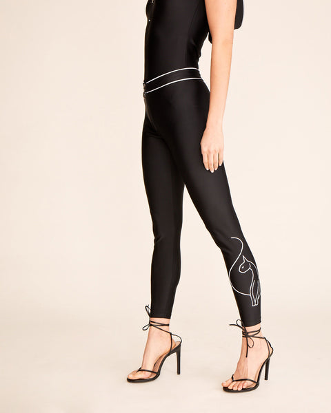 Baby Phat stretch legging features reflective piping and cat logo on the leg. Zip front with silver cat charm.