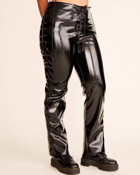 Black vinyl stretch pants with metal Baby Phat cat logo at the back zipper. Lace up sides and front with metal tip cord.