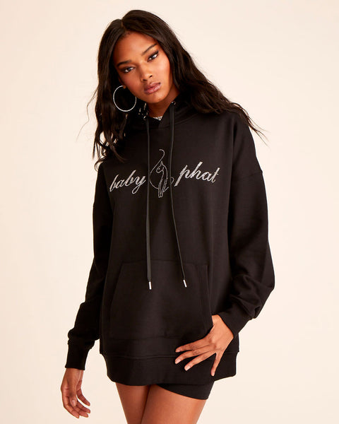 Oversized black french terry hoodie with Baby Phat rhinestone logo at front. Features long sleeves, kangaroo pocket, draw strings with metal tips, and an embossed leather patch at the back.