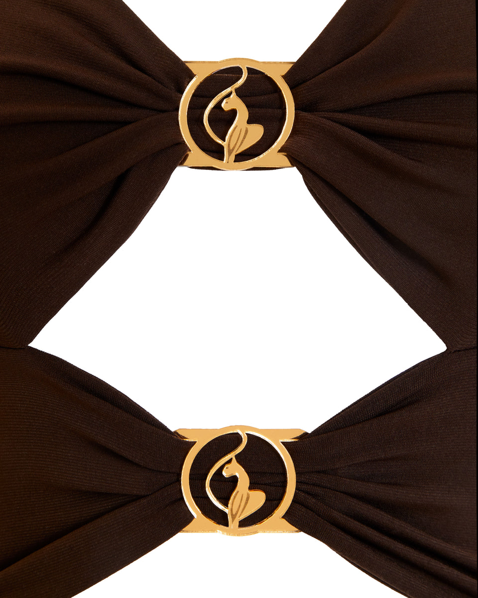 Baby Phat cutout dress in brown. Dress features gold metallic logo cat rings at the front.