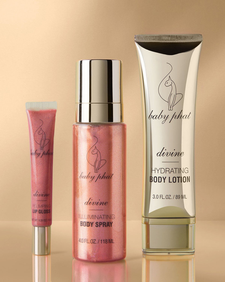 Baby Phat Beauty Shimmer Dreams Gift Set in Divine. Features metallic gold accents and cat logos throughout.