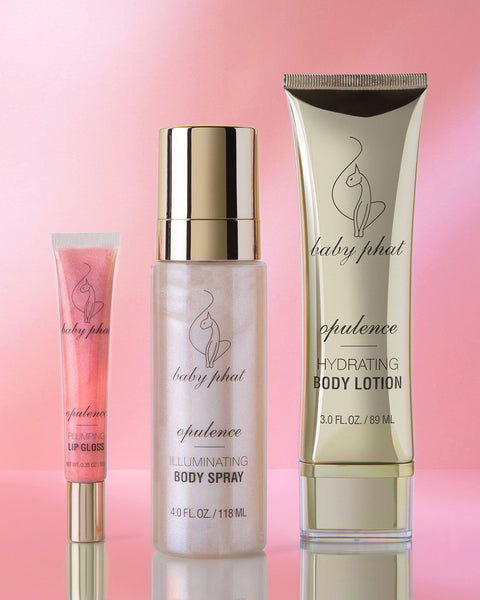 Baby Phat Beauty Shimmer Dreams Gift Set in Opulence. Features metallic gold accents and cat logos throughout.