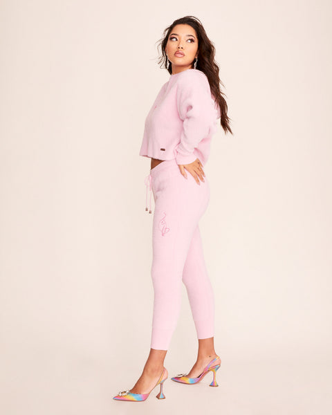 Pink Baby Phat fuzzy joggers feature hot pink embroidered cat logo at the front and rose gold metal tips on the drawstring.