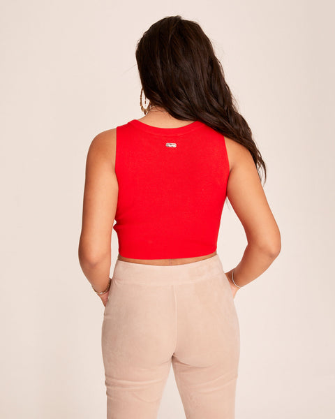Red sleeveless knit sweater tank features Baby Phat embroidered tonal logo at the front. Round neckline and cropped, tight fit.