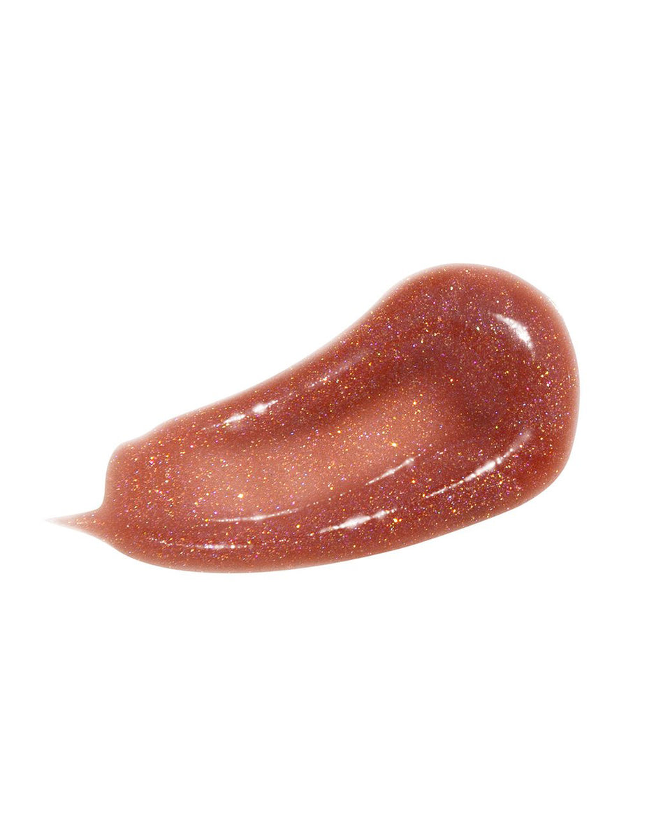 Baby Phat Beauty Plumping Lip Gloss in Divine. Glitter lip gloss features metallic gold cap and cat logo at center.