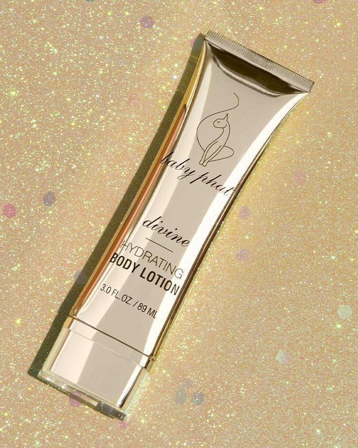 Baby Phat Beauty Hydrating Body Lotion in Divine. Packaging features metallic gold exterior and cat logo on center.