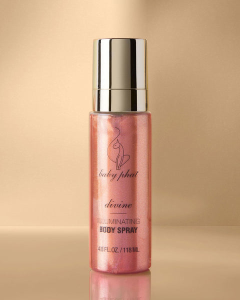 Baby Phat Beauty Illuminating Body Spray in Divine. Glitter body spray features metallic gold cap and cat logo on center.