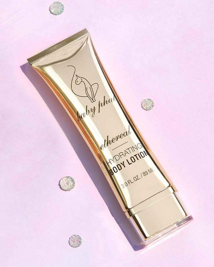 Baby Phat Beauty Hydrating Body Lotion in Ethereal. Packaging features metallic gold exterior and cat logo on center.