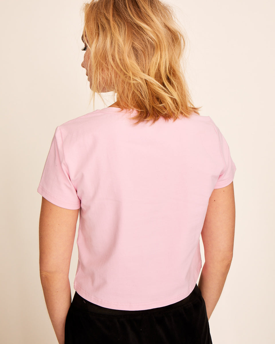 Short sleeved pink cotton t-shirt with Baby Phat silver logo at the front. Soft, stretchy fabric and cropped, boxy fit.
