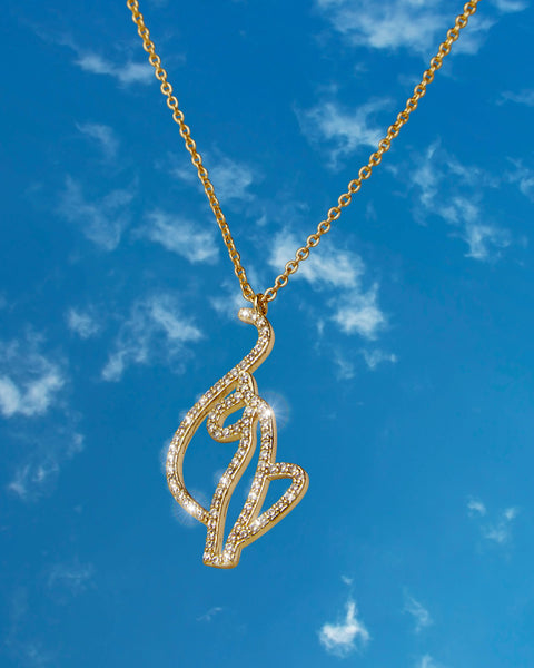 Baby Phat Diamond Kitty Pendant features gold metal finish and pave crystal diamond detailing on the cat logo.