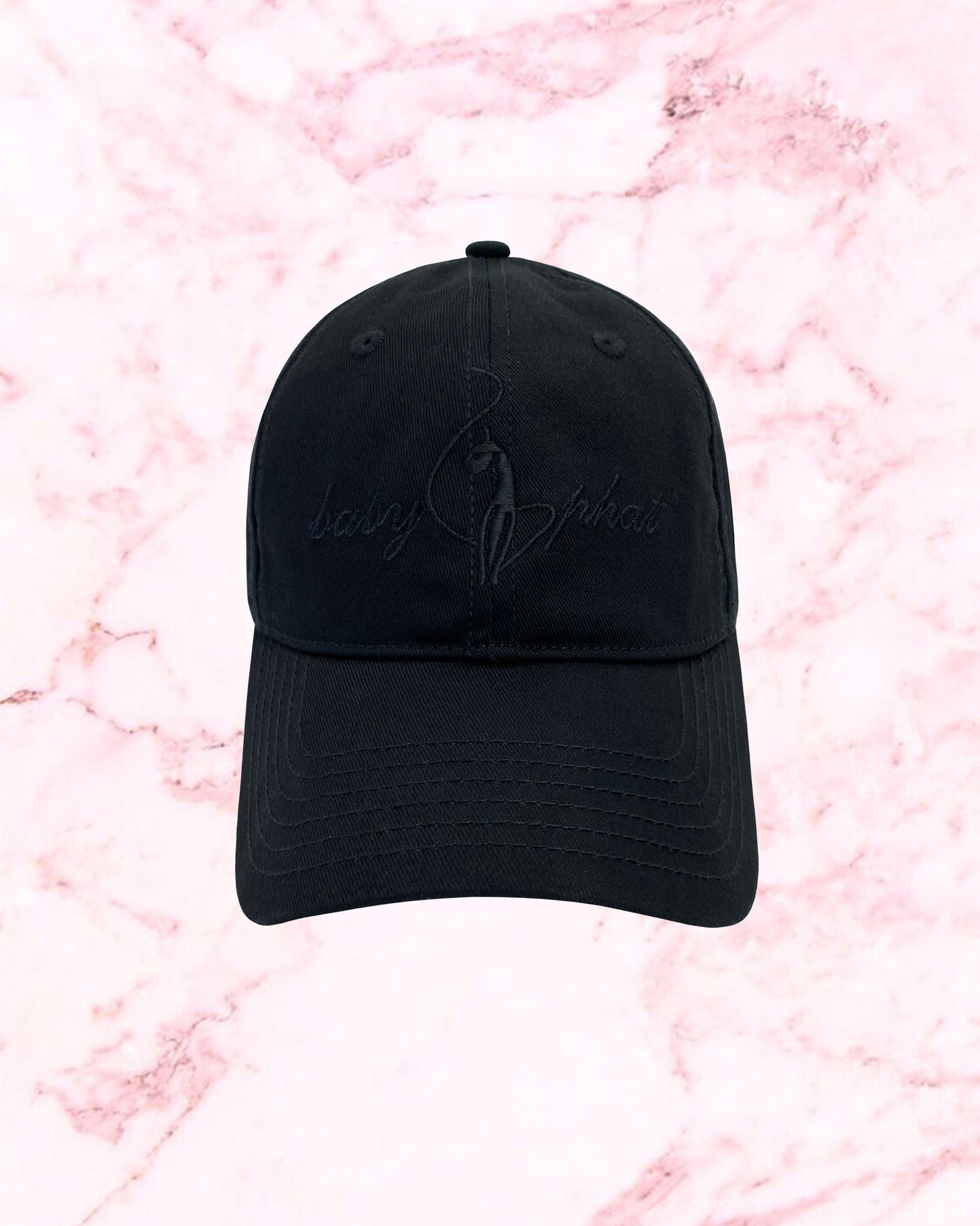 Black baseball hat features Baby Phat logo embroidered at front.