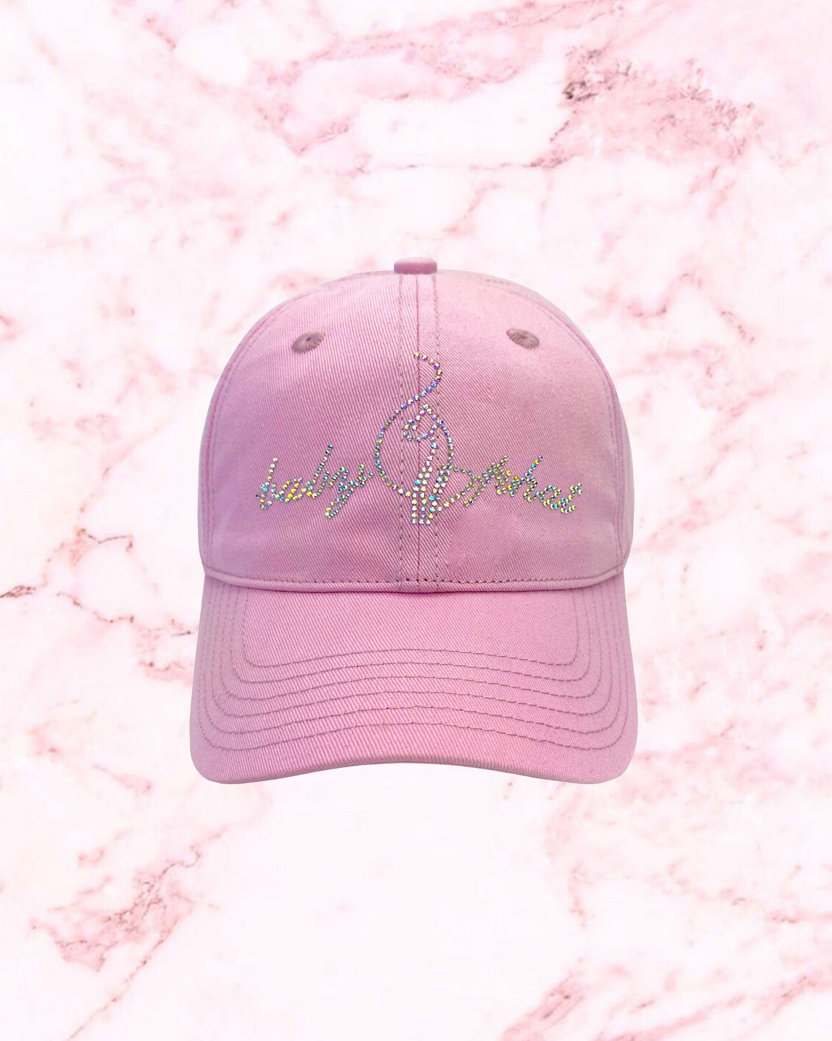 Pink baseball hat features Baby Phat iridescent crystal logo at front.