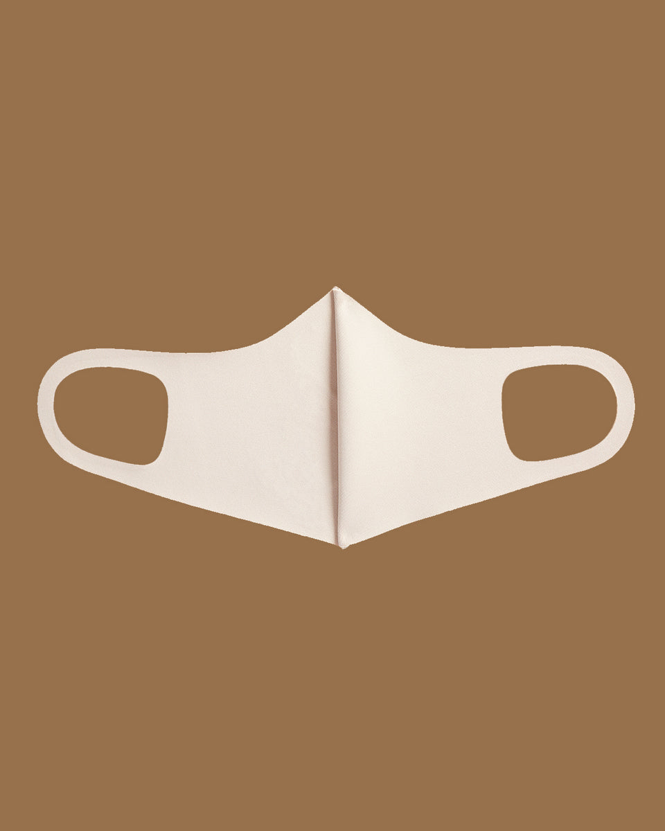Baby Phat crystal logo face mask in nude features nude fabric with a chocolate brown crystal cat logo at the front.