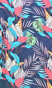 Travel scarf featuring hidden pocket in a navy tropical print