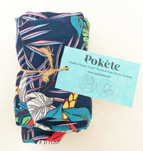 Load image into Gallery viewer, Travel scarf featuring hidden pocket in a navy tropical print