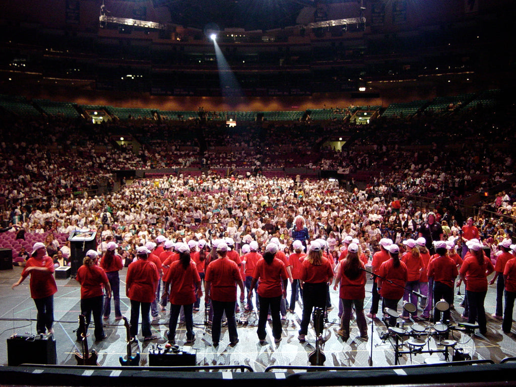 Melinda leading a 200 girl choir performance to a sold-out audience at Madison Square Gardens 2002
