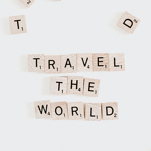 Scrabble pieces spelling out Travel the World