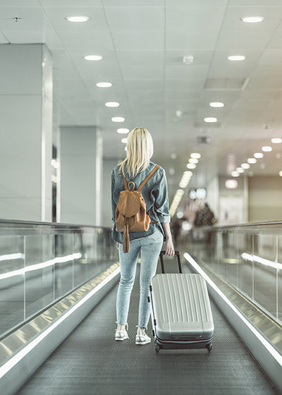 Girl at airport with luggage
